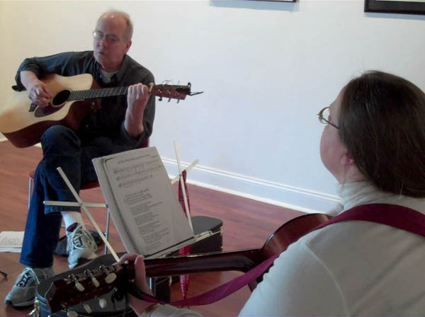 Photo of singing and guitar playing at a NAA Sunday Music Jam