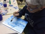 Student painting watercolor